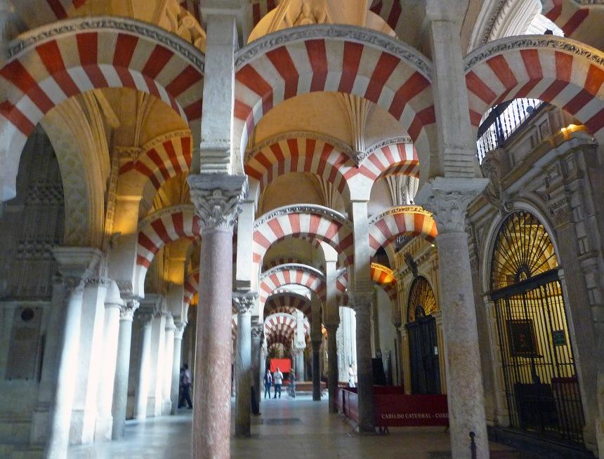 The pillars seem to go on forever. Mezquita, Cordoba, Spain
