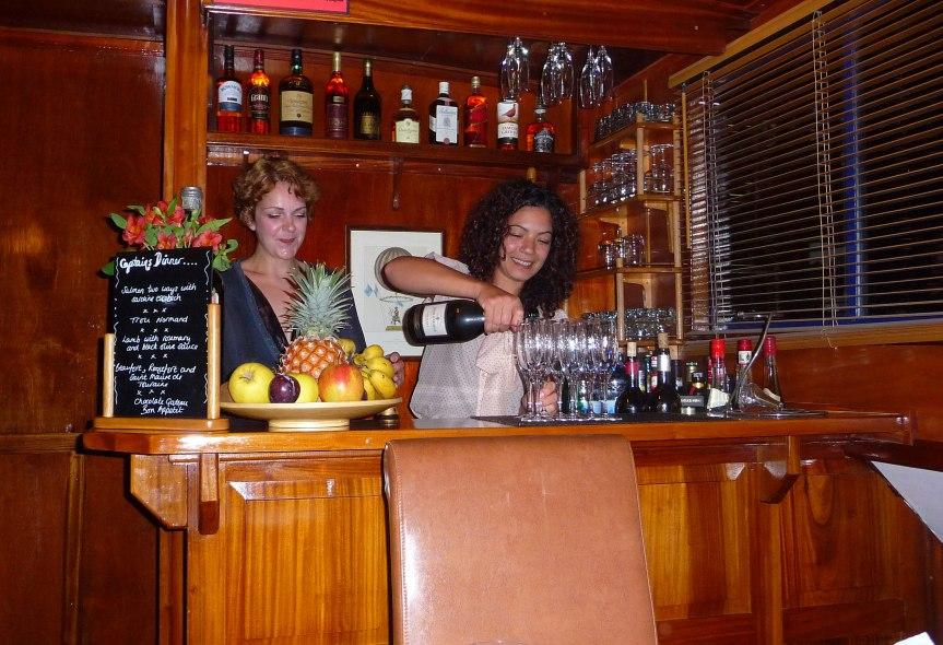 Chef Lauren and hostess Alex prepare pre-dinner drinks.