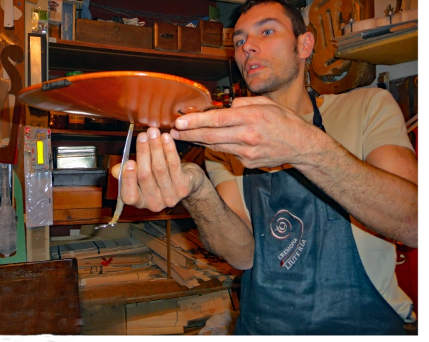 Stefano demonstrates his method of violin making