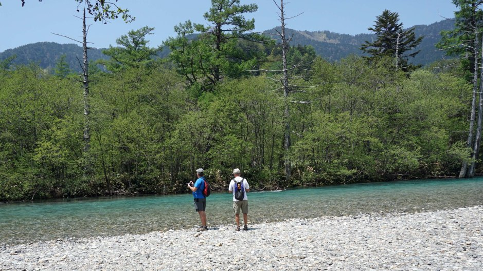 Hikers along the river in Kamikochi