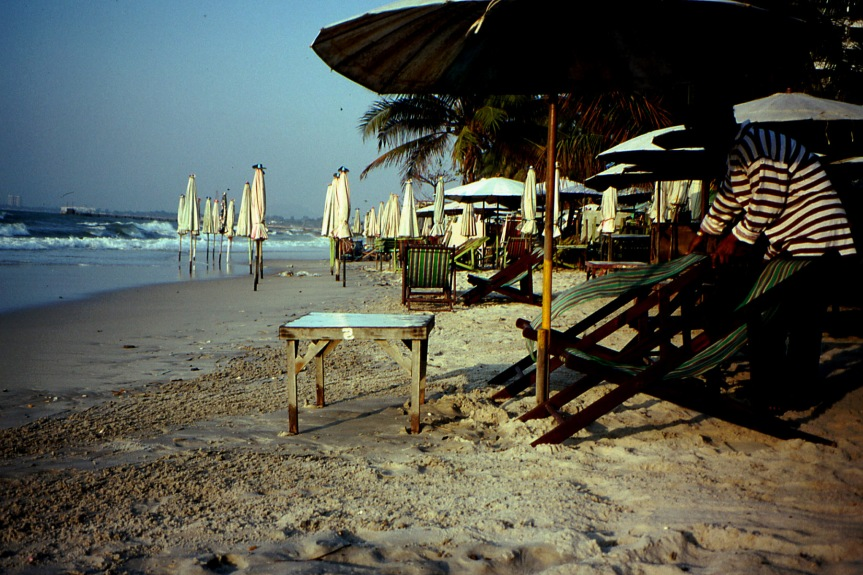 Setting out the Deck Chairs, Dawn at Hua Hin Beach, Thailand