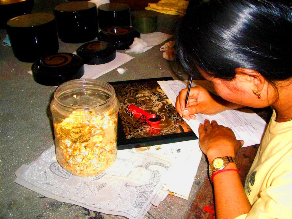 applying-gold-leaf-landmine-victims-school-in-vietnam