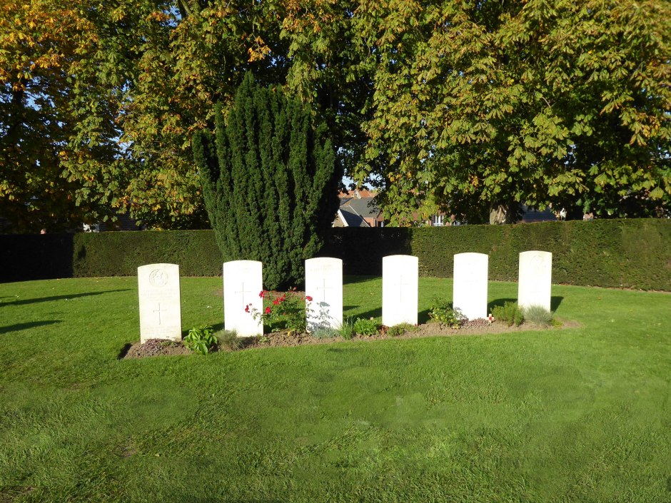 Ypres-cemetery---Headstones-to-a-few-of-the-fallen