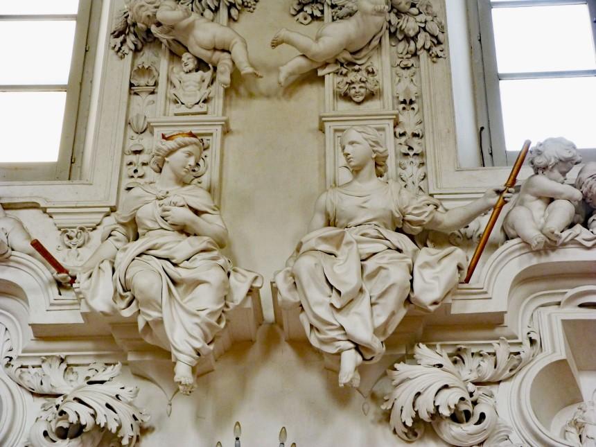 Notice the devil above the statue