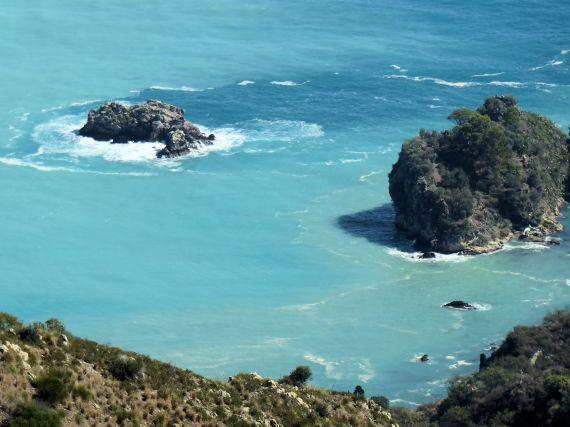 Turquoise seas surrounding Isola Bella at Taormina