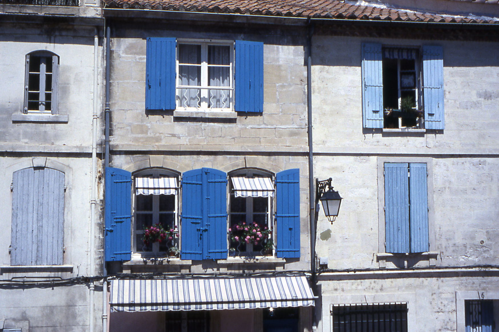 Blue shutters on house in Arles